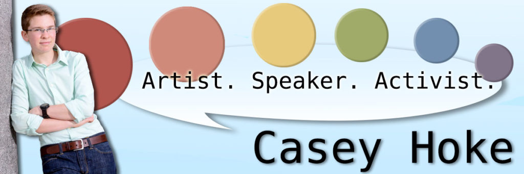 Casey leans against the right side in a light blue dress shirt and dark trousers. Circles in the colour of a pastel rainbow arch across the banner and underneath it reads: Artist. Speaker. Activist. Casey Hoke.