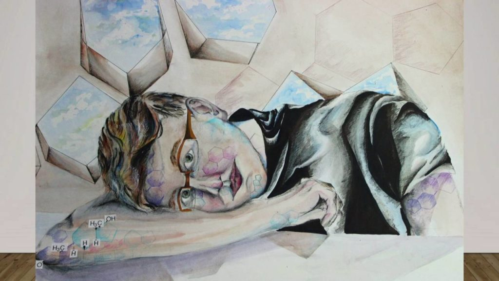 In this painted self-portrait, Casey lays his head on his right arm and looks out at the viewer through his glasses. The colours of the transgender pride flag are woven throughout, as are testosterone molecules used to abstract Casey's face and the background.